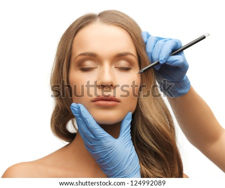 picture of woman face and beautician hands with pencil