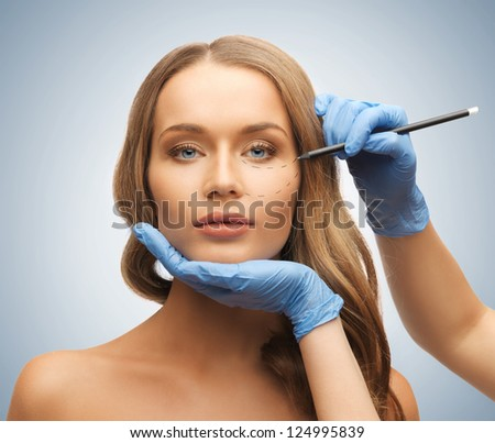 picture of woman face and beautician hands with pencil - stock photo