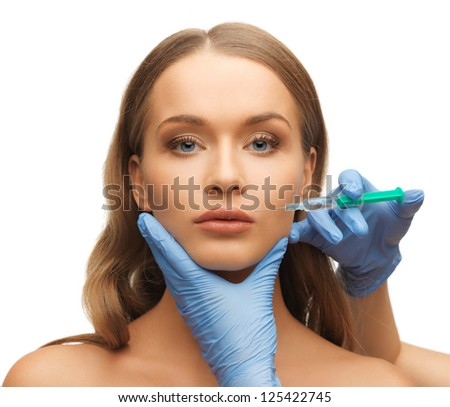 picture of woman face and beautician hands with syringe