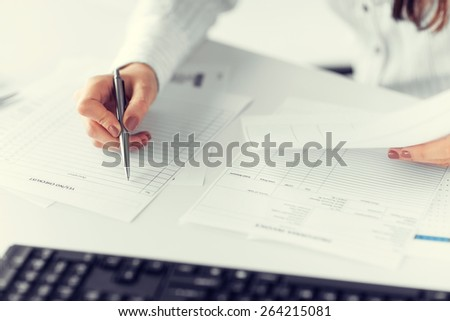 picture of woman hand filling in blank paper or document - stock photo