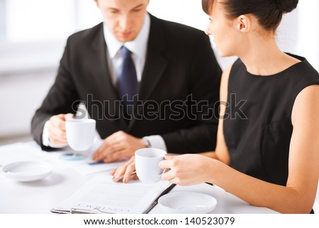 picture of woman hand signing contract paper - stock photo