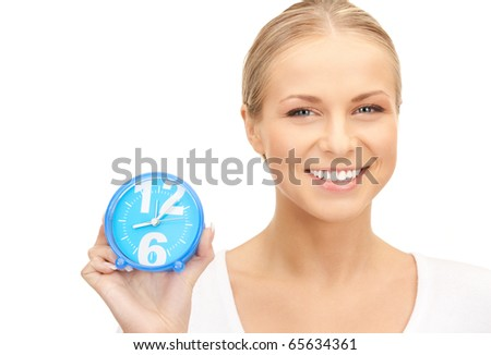 picture of woman holding alarm clock over white - stock photo