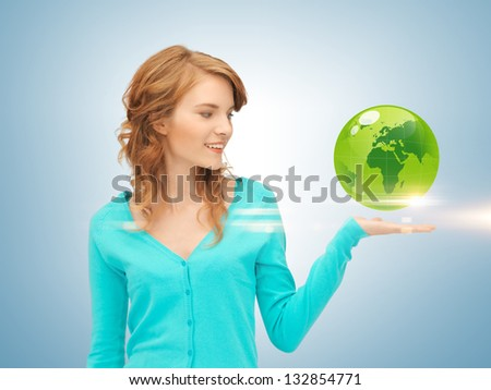 picture of woman holding green globe on her hand - stock photo