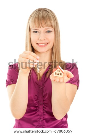 Picture of woman  holding house and keys isolated (focus on woman) - stock photo