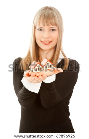 Picture of woman holding two toy house (focus on house) - stock photo