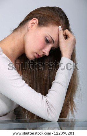 picture of woman in profile looking depressed - stock photo