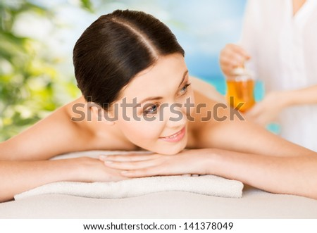 picture of woman in spa salon getting oil treatment - stock photo