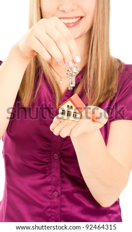Picture of woman's hands holding house and keys - stock photo