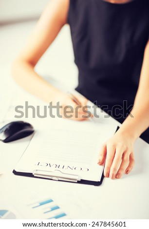 picture of woman thinking about signing a contract - stock photo
