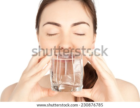 Picture of woman with a glass of water isolated on white - stock photo