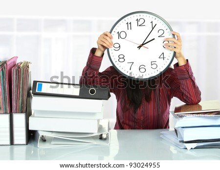 picture of woman with big clock covering her face - stock photo