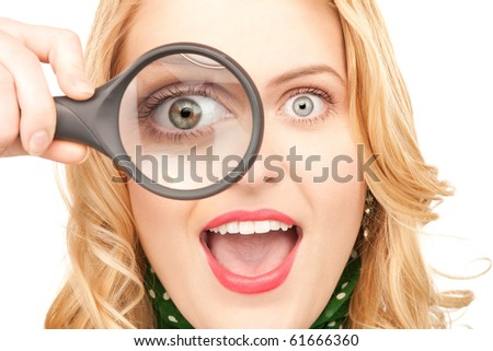 picture of woman with magnifying glass over white - stock photo