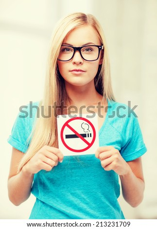picture of woman with smoking restriction sign . - stock photo
