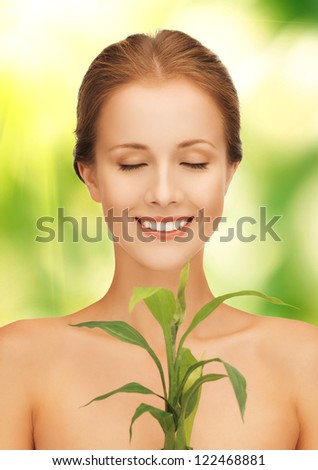 picture of woman with sprout over green background - stock photo