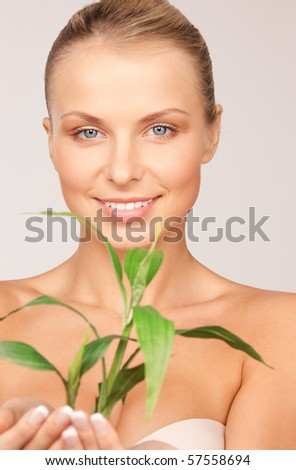 picture of woman with sprout over grey - stock photo