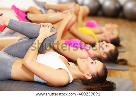 Picture of women group stretching in gym - stock photo