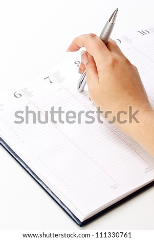 Picture of women hand whit pen and daily planner - stock photo