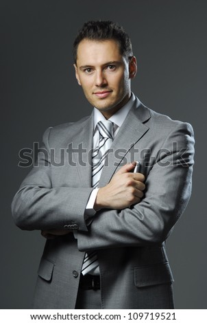 Picture of yang and confident man in business suit. - stock photo