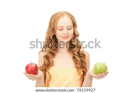 picture of young beautiful woman with green and red apples