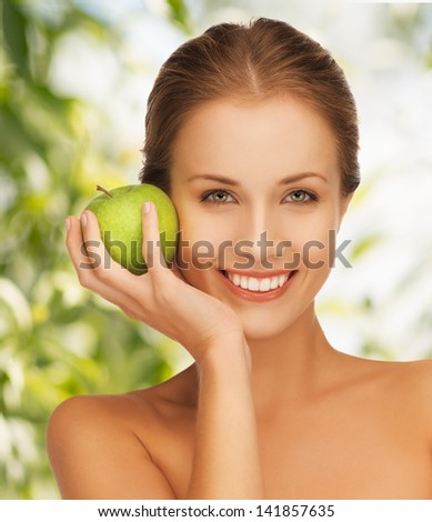 picture of young beautiful woman with green apple. - stock photo