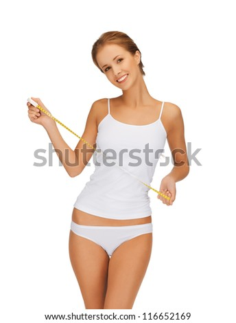 picture of young beautiful woman with measure tape - stock photo