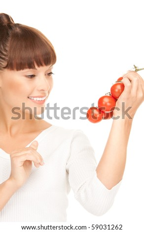 picture of young beautiful woman with ripe tomatoes - stock photo