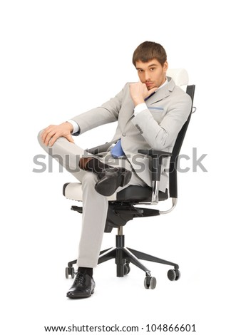 picture of young businessman sitting in chair - stock photo