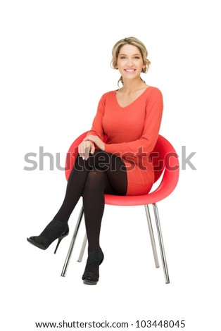 picture of young businesswoman sitting in chair - stock photo