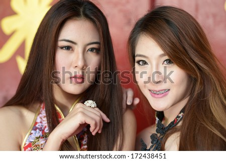 Picture of young chinese woman wearing traditional cheongsam  - stock photo