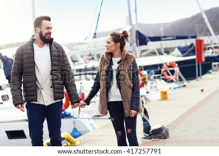 Picture of young couple hanging out in city