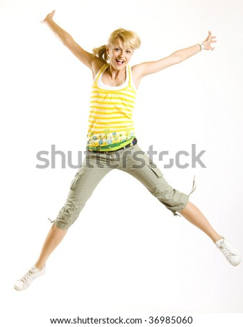 picture of young girl jumping for joy over white