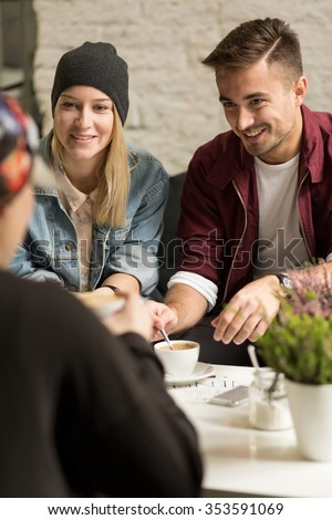 Picture of young happy people spending time together - stock photo