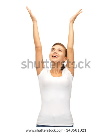 picture of young happy woman with hands up - stock photo