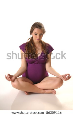 Picture of young pregnant woman doing stretching - stock photo