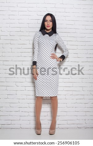 picture of young woman in white dress on high heels - stock photo