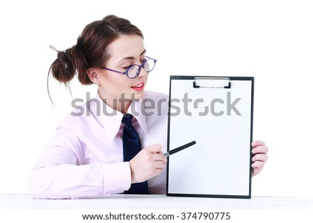 Picture of young woman student at the desk showing blank signboard - stock photo