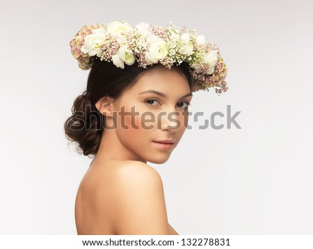 picture of young woman wearing wreath of flowers . - stock photo