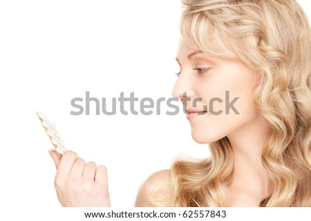 picture of young woman with pills over white - stock photo