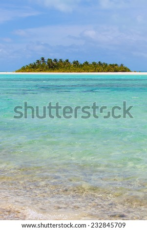 picture perfect island in breathtaking turquoise lagoon at aitutaki, cook islands - stock photo