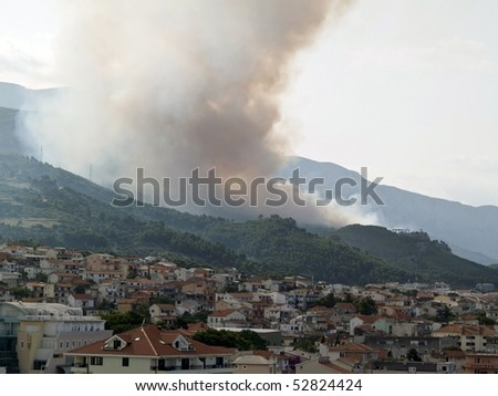 Picture present forest fire over the city in Croatia - stock photo