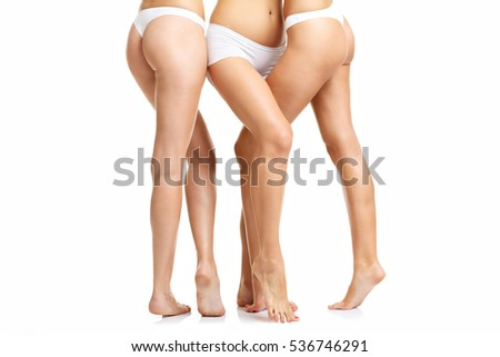Picture showing downsection of happy friends posing in underwear