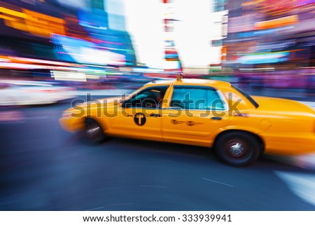 picture with camera made motion blur effect of traffic at night at Times Square, Manhattan, NYC - stock photo