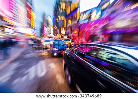 picture with camera made zoom effect of a traffic scene in Manhattan, NYC, at night - stock photo