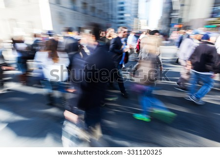 picture with creative blur and zoom effect made by camera of commuters walking on the street