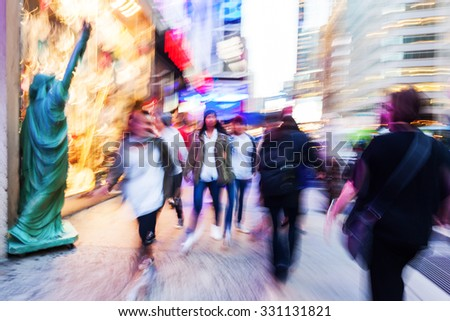 picture with creative blur effect made by camera of people walking along the Broadway in New York City