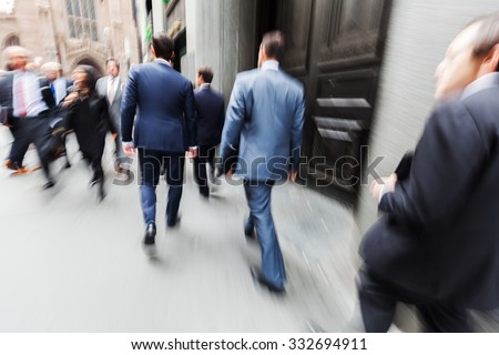 picture with creative motion blur effect made by camera from business people on the move at Wall Street, Manhattan, NYC - stock photo
