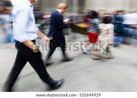 picture with creative motion blur effect made by camera from business people on the move in the city
