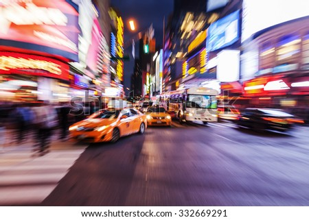 picture with creative zoom effect made by camera of cars and yellow cabs in Manhattan, New York City, at night - stock photo