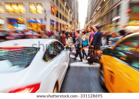 picture with creative zoom effect of a street scene with crossing people in Manhattan, New York City - stock photo