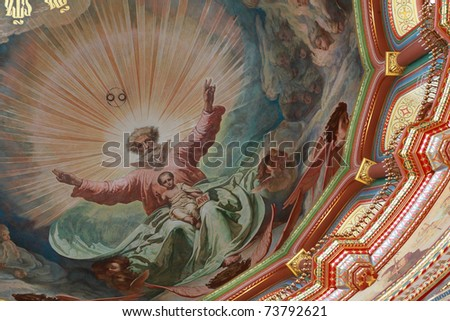 Pictured ceiling adorned by candles inside Cathedral of Christ the Saviour in Moscow, Russia - stock photo